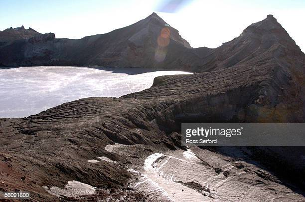 The ash wall on the crater lake on Mount Ruapehu New Zealand Wednesday Mar 16 2004 Scientists are expecting the crater lake to spill over the ash...