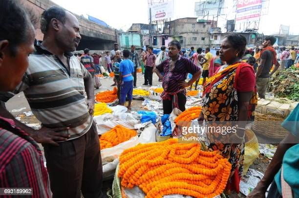 the Asia Biggest Flower Market on June 072017 in KolkataIndiaWholesellers arrive at daybreak with huge consignments of flowers that are then...