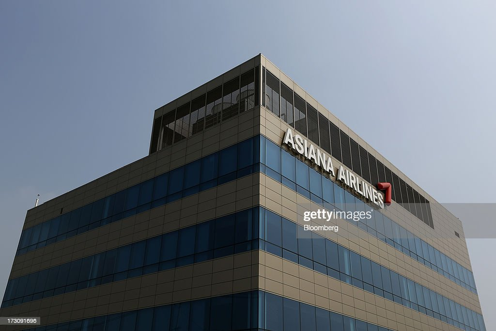 The Asiana Airlines Inc. logo is displayed at the company's headquarters in Seoul, South Korea, on Sunday, July 7, 2013. A Boeing Co. 777 flown by South Korea's Asiana Airlines crashed while landing in San Francisco yesterday, killing two people as passengers escaped down emergency slides before a fire swept through the plane. Photographer: SeongJoon Cho/Bloomberg via Getty Images