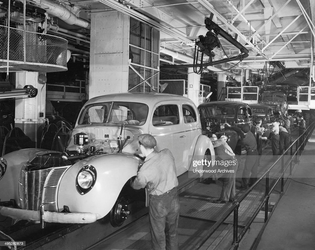 The assembly line for the 1940 ford two door sedan for Motor city towing detroit michigan