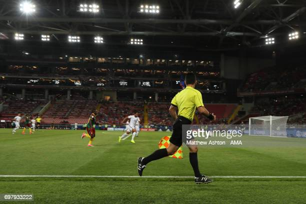 The assistant referee / linesman runs the line A general view of The Spartak Stadium / Otkritie Arena home of Spartak Moscow in Moscow Russia A host...