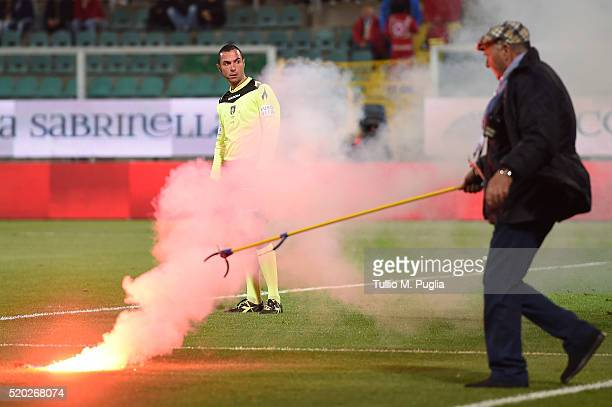 The assistant referee Marco Guida looks on after a flare in thrown onto the pitch during the Serie A match between US Citta di Palermo and SS Lazio...
