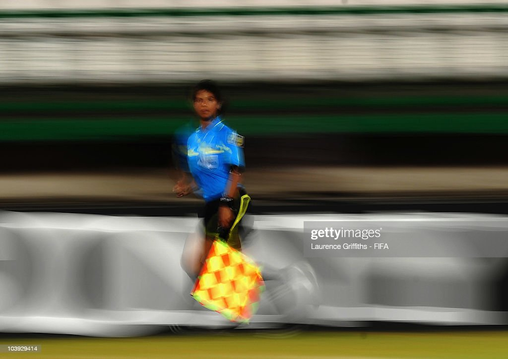 The Assistant Referee runs the line during the FIFA U17 Women's World Cup match between South Korea and Mexico at the Dwight Yorke Stadium on...