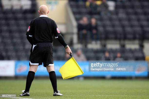 The assistant referee runs the line