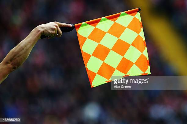 The assistant referee waves his flag during the Bundesliga match between Eintracht Frankfurt and FC Bayern Muenchen at CommerzbankArena on November 8...