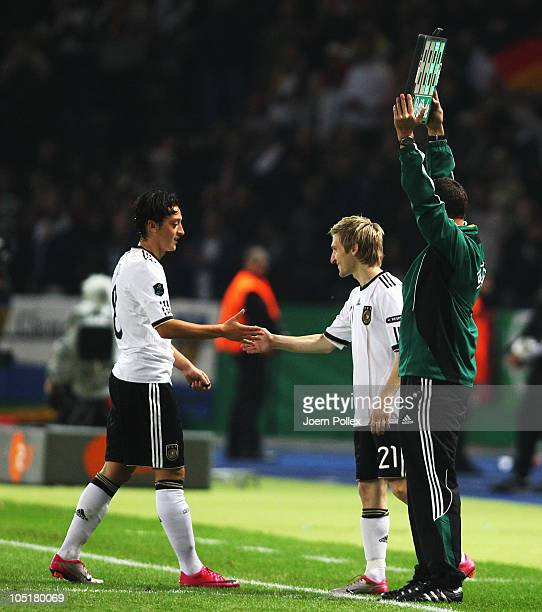 The assistent refferee is seen with the substitiution board during the EURO 2012 Group A qualifier match between Germany and Turkey at Olympia...