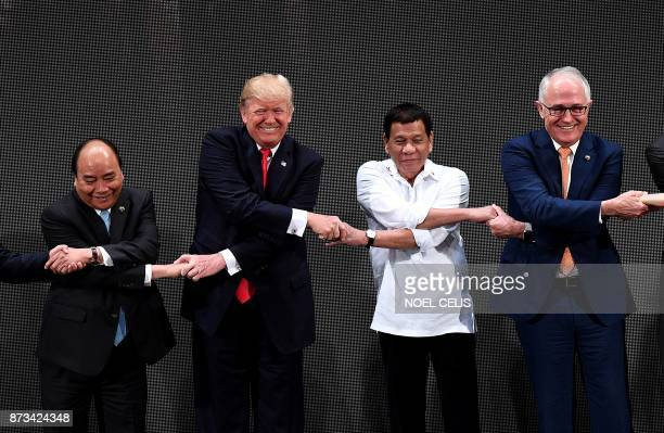 TOPSHOT The Association of Southeast Asian Nations members Vietnam's Prime Minister Nguyen Xuan Phuc US President Donald Trump Philippine President...