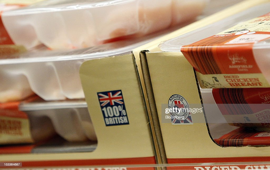 The Assured Food Standards ''Red Tractor'' logo is displayed on a box of diced chicken breasts at a supermarket operated by Aldi Group, Germany's biggest discount-food retailer, in Manchester, U.K., on Thursday, Oct. 4, 2012. U.K. shop-price inflation slowed in September as retailers offered discounts to attract cash-strapped consumers, the British Retail Consortium said. Photographer: Paul Thomas/Bloomberg via Getty Images