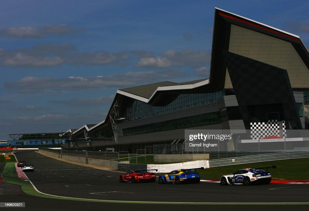 The Aston Martin Racing Aston Martin Vantage GT3 driven by Darren Turner Stefan Mucke and Frederic Makowiecki passes the Silverstone Wing pit complex...