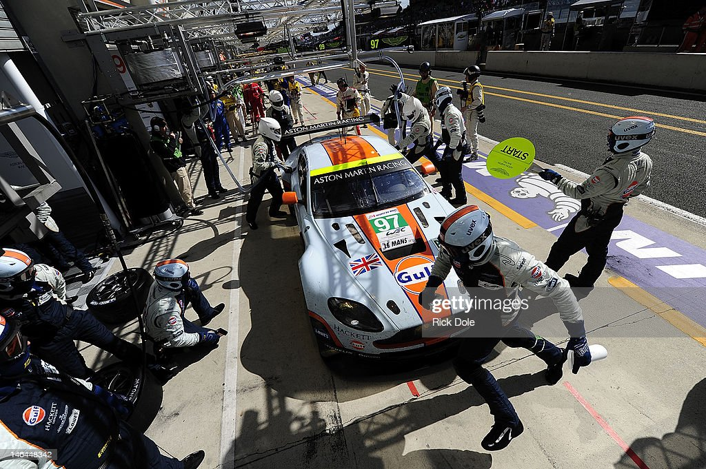 The Aston Martin Racing Vantage driven by Adrian Fernandez of Mexico Darren Turner of England and Stefan Mucke of Germany in for a pit stop during...