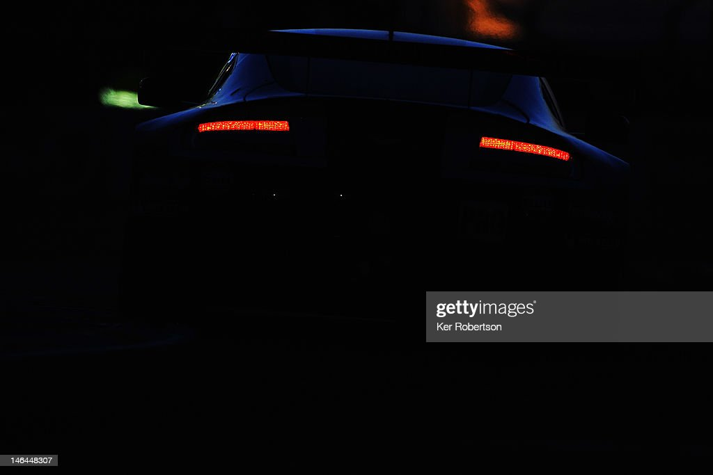 The Aston Martin Racing Vantage V8 of Darren Turner Stefan Mucke and Adrian Fernandez drives during the Le Mans 24 Hour race at the Circuit de la...
