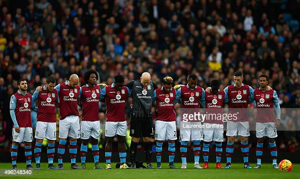 The Aston Villa players observe a minutes silence on Remembrance Sunday prior to kickoff during the Barclays Premier League match between Aston Villa...