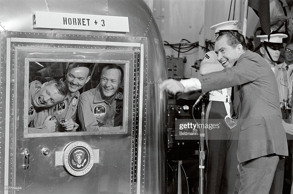 The astronauts of Apollo 11 - left to right, <a gi-track='captionPersonalityLinkClicked' href=/galleries/search?phrase=Neil+Armstrong&family=editorial&specificpeople=92197 ng-click='$event.stopPropagation()'>Neil Armstrong</a>, <a gi-track='captionPersonalityLinkClicked' href=/galleries/search?phrase=Michael+Collins+-+Astronaut&family=editorial&specificpeople=95470 ng-click='$event.stopPropagation()'>Michael Collins</a>, and <a gi-track='captionPersonalityLinkClicked' href=/galleries/search?phrase=Buzz+Aldrin&family=editorial&specificpeople=90480 ng-click='$event.stopPropagation()'>Buzz Aldrin</a> - react with amusement to something President Nixon has done. The three were being held in the mobile quarantine facility aboard the USS Hornet following their return to Earth from the Moon.