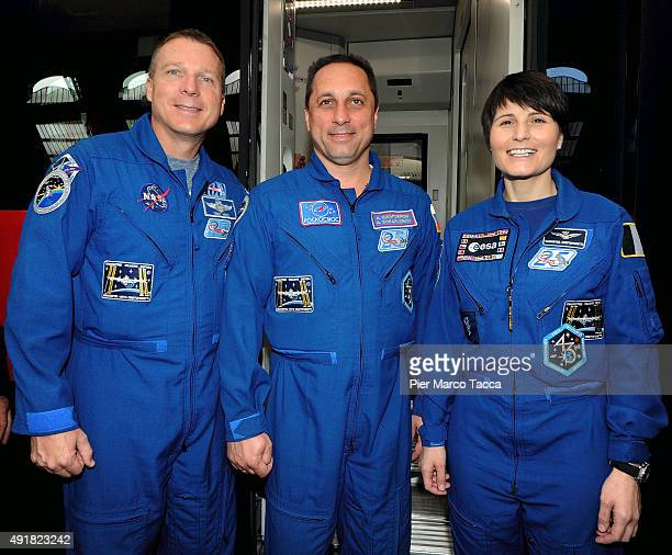 The astronauts Terry Virts of NASA Samantha Cristoforetti of ESA space agency and Anton Shkaplerov of Roscomos space agency pose at the end of the...