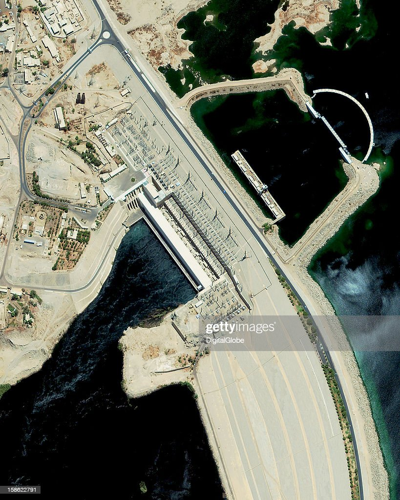 The Aswan Dam was completed in 1970 at a cost of $1 billion. The dam reaches 364 ft (111 meter) high and is a rockfill dam or embankment dam that controls the flow of the world's longest river the Nile. Water from the Nile River is collected in Lake Nasser which is the world's third largest reservoir. Commonly referred to as the High Dam after the 1950's this portion was completed between 1960 and 1970 to control annual flooding and generate electricity. About half of Egypt's power is generated here.