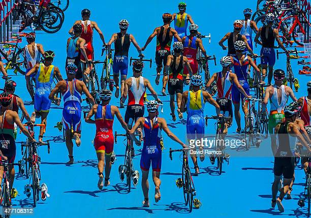 The athletes dismount from their bike in the Men's Triathlon Final during day two of the Baku 2015 European Games at Bilgah Beach on June 14 2015 in...