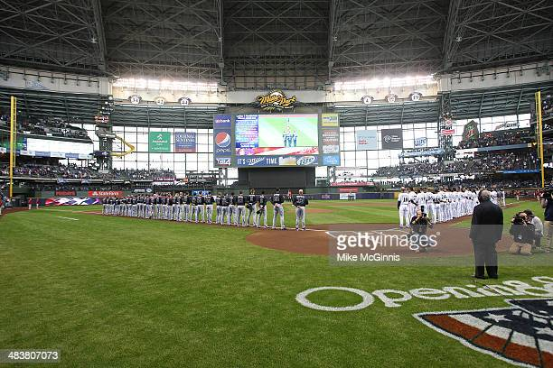 The Atlanta Braves and the Milwaukee Brewers line the field for the opening announcements before the start of Opening Day at Miller Park on March 31...