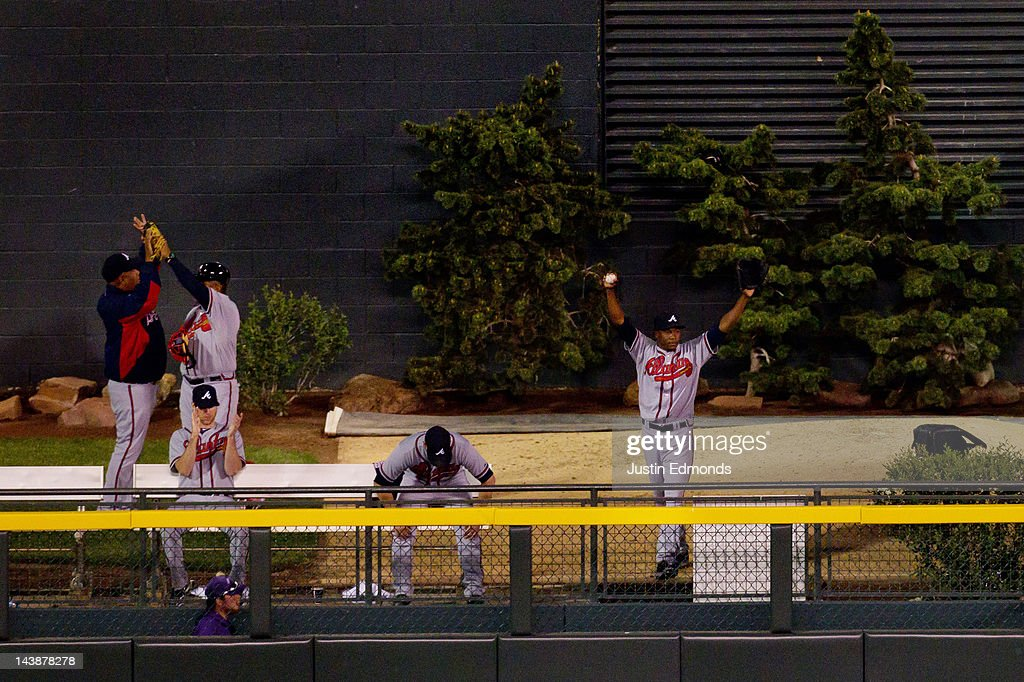 The Atlanta Braves bullpen celebrates a two-run home run by Eric Hinske in the top of the 11th inning against the Colorado Rockies at Coors Field on May 4, 2012 in Denver, Colorado. They proved to be the winning runs as the Braves defeated the Rockies 9-8 in 11 innings.
