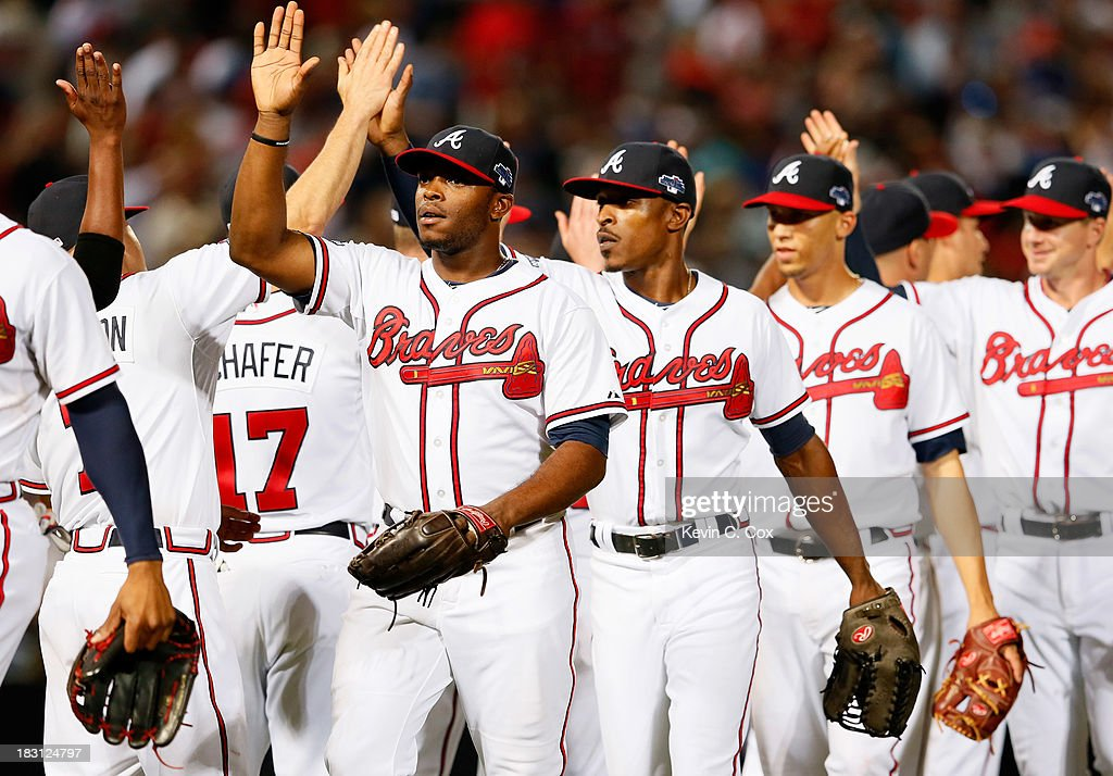 The Atlanta Braves celebrate after defeating the Los Angeles Dodgers during Game Two of the National League Division Series at Turner Field on October 4, 2013 in Atlanta, Georgia.