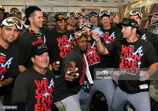 The Atlanta Braves celebrate their National League East Championship on September 22 2013 at Wrigley Field in Chicago Illinois The Atlanta Braves...
