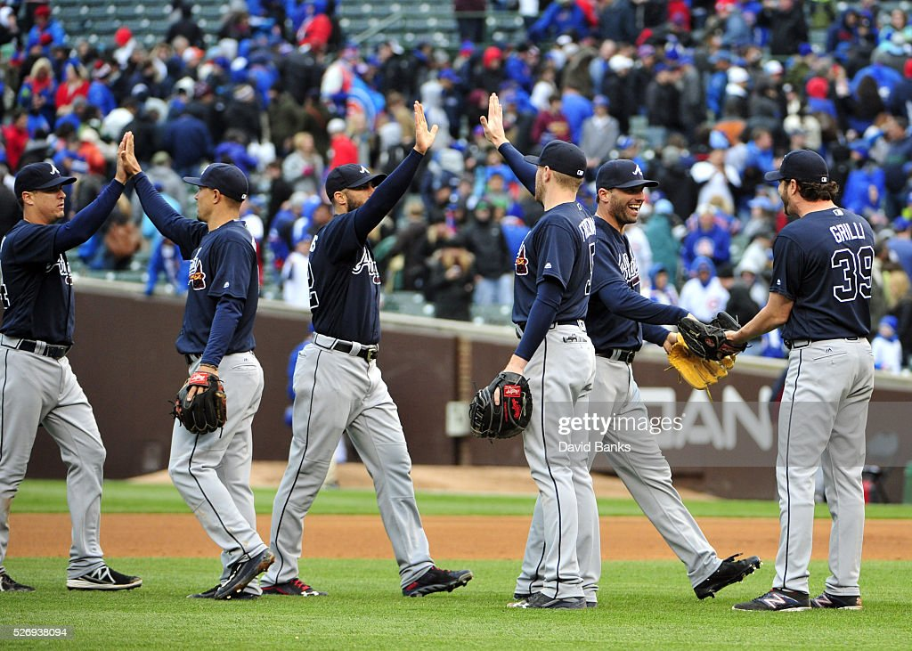 The Atlanta Braves celebrate their win against the Chicago Cubs on May 1, 2016 at Wrigley Field in Chicago, Illinois. The Braves won 4-3 in ten innings.