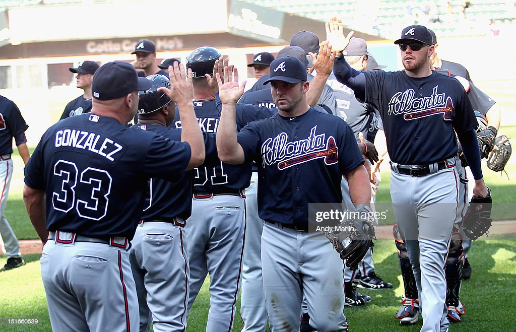 The Atlanta Braves high five each other after defeating the New York Mets at Citi Field on September 9, 2012 in the Flushing neighborhood of the Queens borough of New York City. The braves defeated the Mets 3-2 in 10 innings.