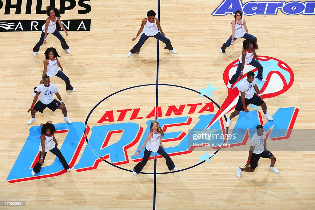 The Atlanta Dream dance team performs during halftime of the game against the Seattle Storm at Philips Arena on June 14, 2013 in Atlanta, Georgia.