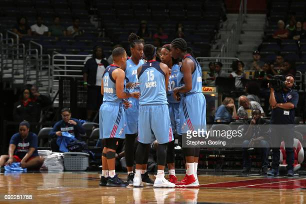 The Atlanta Dream huddles during the game against the Washington Mystics on June 4 2017 at Verizon Center in Washington DC NOTE TO USER User...