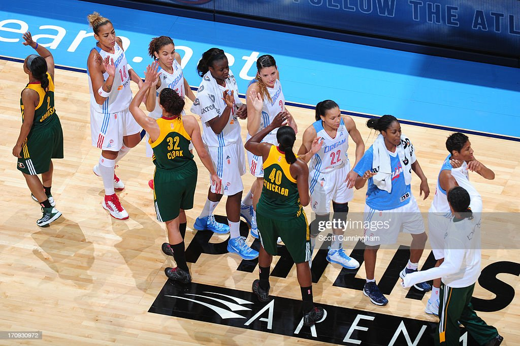 The Atlanta Dream shakes hands with the Seattle Storm after the game at Philips Arena on June 14, 2013 in Atlanta, Georgia.