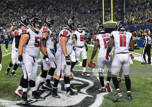 The Atlanta Falcons celebrate a touchdown by Mohamed Sanu in the first quarter of the game at CenturyLink Field on November 20 2017 in Seattle...