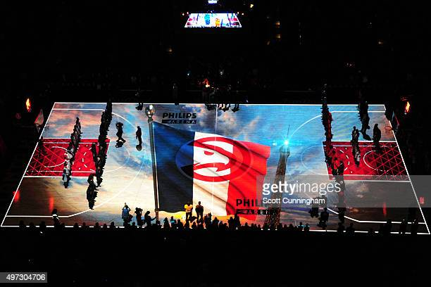 The Atlanta Hawks and the Utah Jazz stand for a moment of silence for Paris France on November 15 2015 at Philips Center in Atlanta Georgia NOTE TO...
