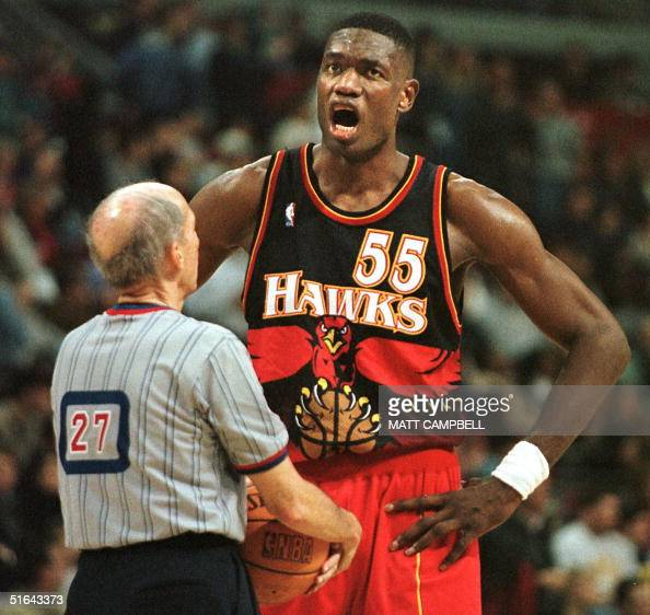 The Atlanta Hawks' Dikembe Mutombo complains to referee Dick Bavetta after a foul call went against Atlanta with less than a minute left in the game...