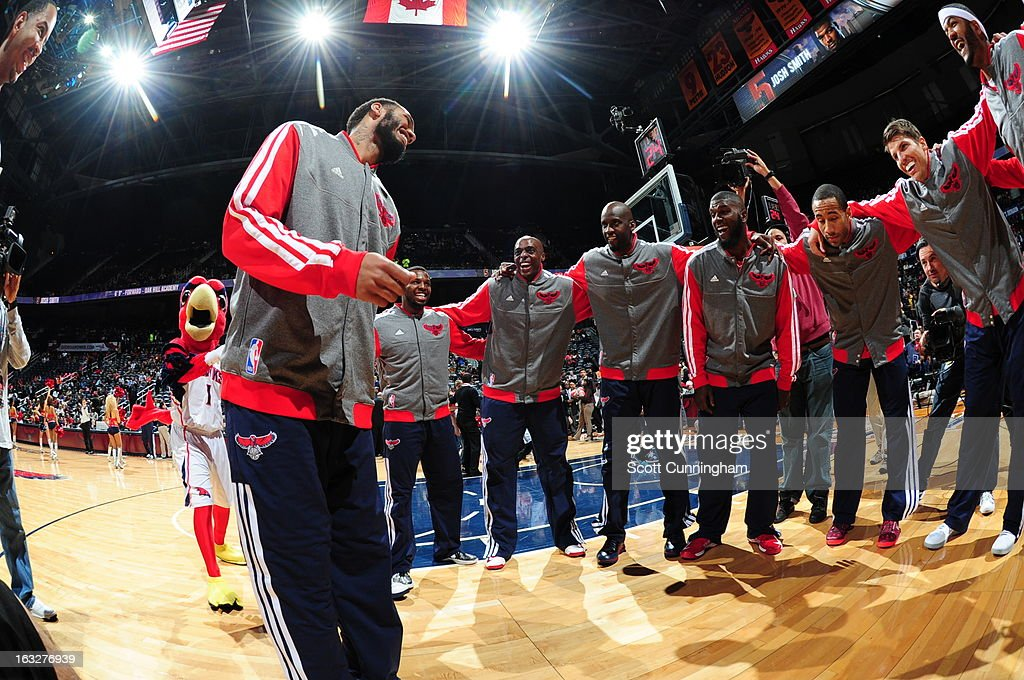 The Atlanta Hawks huddle before the game against the Philadelphia 76ers on March 6, 2013 at Philips Arena in Atlanta, Georgia.