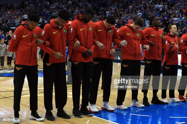 The Atlanta Hawks lock arms during the national anthem at American Airlines Center on October 18 2017 in Dallas Texas NOTE TO USER User expressly...