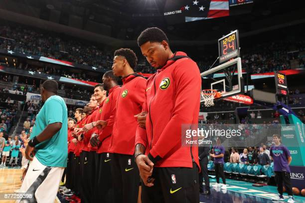 The Atlanta Hawks stands for the National Anthem before the game against the Charlotte Hornets on October 20 2017 at Spectrum Center in Charlotte...