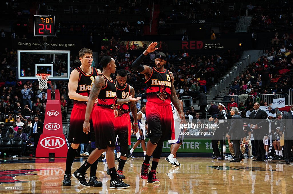 The Atlanta Hawks walk off the court during a timeout against the Sacramento Kings on February 22, 2013 at Philips Arena in Atlanta, Georgia.
