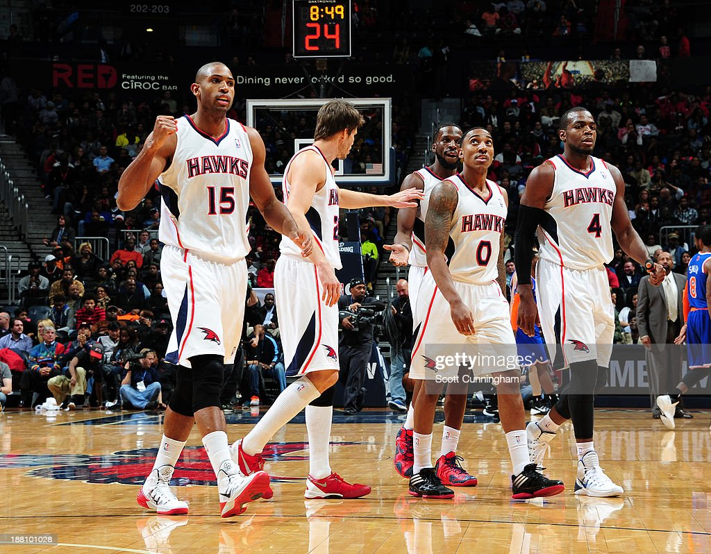 The Atlanta Hawks walk off the court during the game against the New York Knicks on November 13, 2013 at Philips Arena in Atlanta, Georgia.