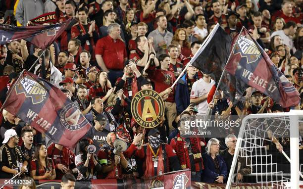 The Atlanta United fans cheer during the game against the New York Red Bulls at Bobby Dodd Stadium on March 5 2017 in Atlanta Georgia