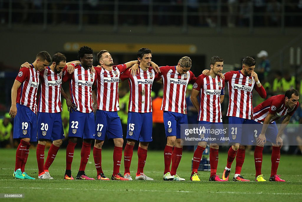 The Atletico Madrid players react during a penalty shootout during the UEFA Champions League final match between Real Madrid and Club Atletico de Madrid at Stadio Giuseppe Meazza on May 28, 2016 in Milan, Italy.