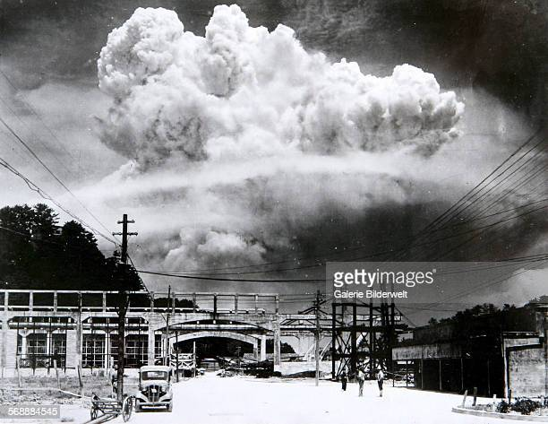 The atomic bomb mushroom cloud over Nagasaki seen from Koyagijima 9th August 1945 The plutonium implosiontype bomb was dropped off a Boeing B29...