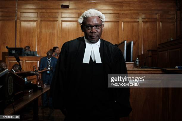 The Attorney General of the Republic of Kenya Githu Muigai poses on November 20 2017 before the Kenya's Supreme Court dismissed two petitions to...