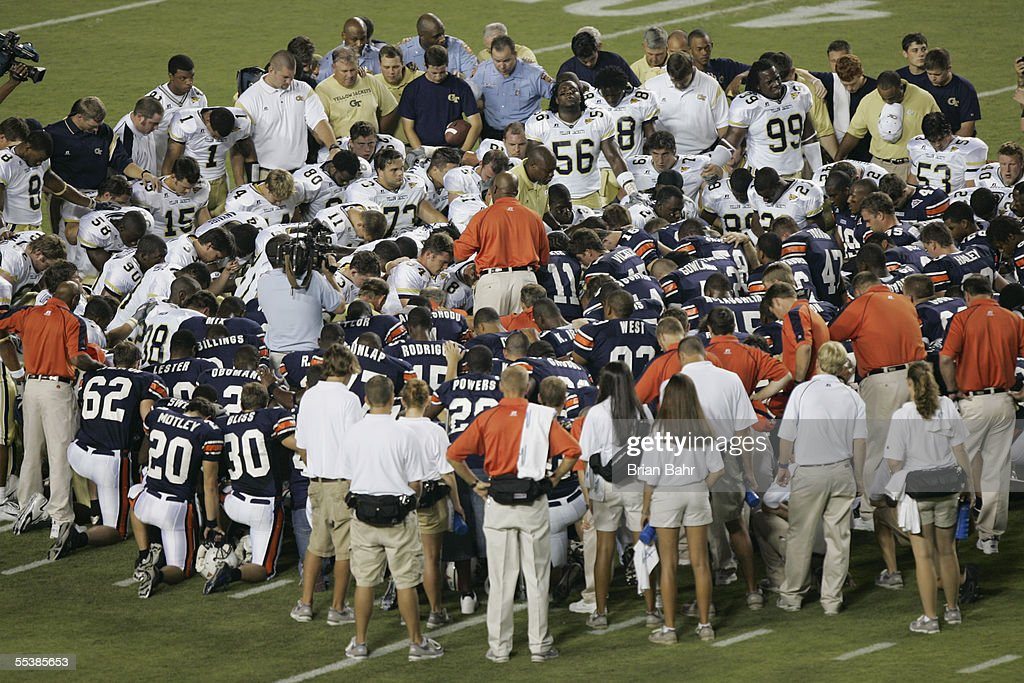 The Auburn Tigers and the Georgia Tech Yellow Jackets players gather for a prayer for hurricane Katrina victims before the game on September 3 2005...