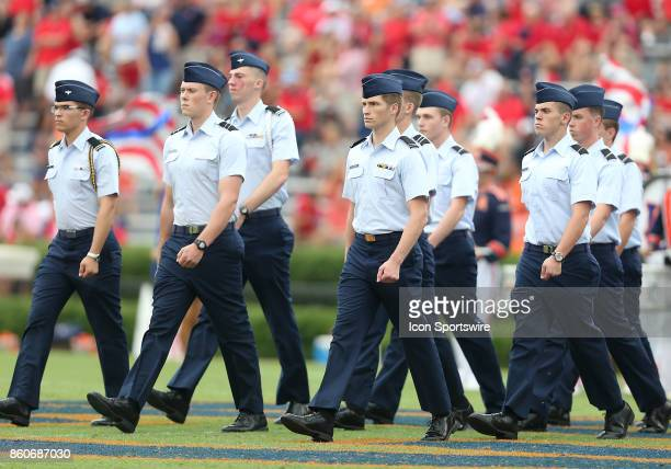 The Auburn Tigers marching band pays tribute to the US Military during halftime of a football game between the Auburn Tigers and the Ole Miss Rebels...