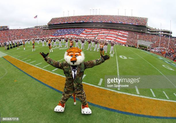 The Auburn Tigers marching band pays tribute to the US Military with mascot Aubie in the foreground during halftime of a football game between the...