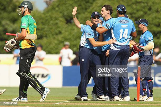 The Auckland Aces celebrate their win as Michael Mason of the Stags walks away following the final of the HRV Cup Twenty20 match between the Auckland...