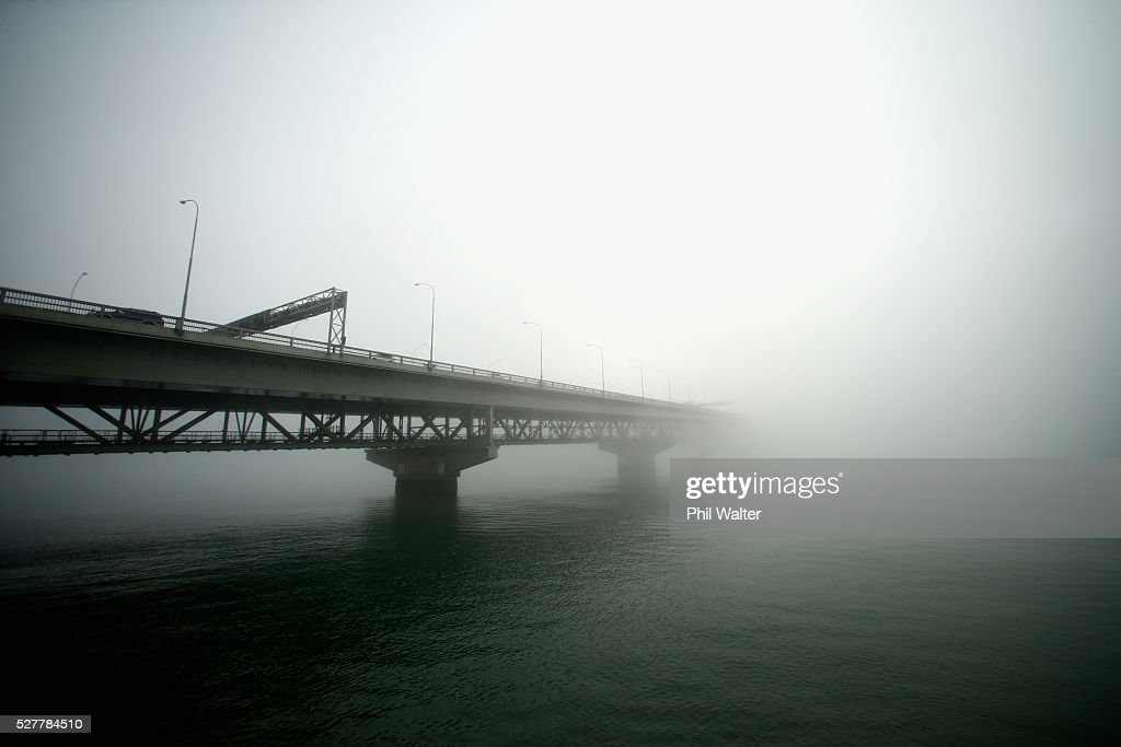 The Auckland Harbour Bridge struggles to break through a blanket of fog over Auckland City on May 4, 2016 in Auckland, New Zealand. The morning fog disrupted flights and ferry services in the city.