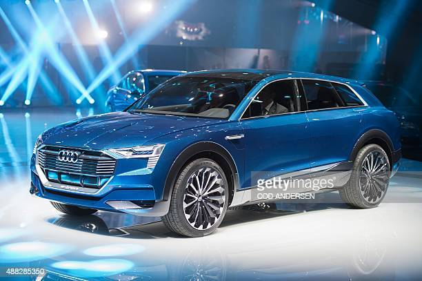 The Audi quattro electric drive concept car SUV is displayed at the German carmaker Audi AG booth at a press day of the 66th IAA auto show in...