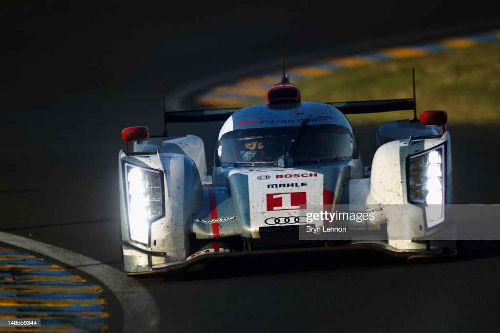 The Audi R18 Etron Quattro driver <a gi-track='captionPersonalityLinkClicked' href=/galleries/search?phrase=Andre+Lotterer&family=editorial&specificpeople=2380096 ng-click='$event.stopPropagation()'>Andre Lotterer</a> of Germany in action during Le Mans 24 Hour race at the Circuit de la Sarthe on June 17, 2012 in Le Mans, France.