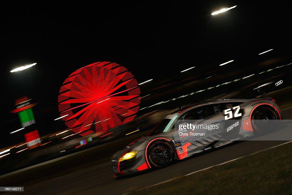The #52 Audi Sport Customer Racing driven by Frank Stippler, Rene Rast, Ian Baas and Marc Basseng, drives during the Rolex 24 at Daytona International Speedway on January 26, 2013 in Daytona Beach, Florida.