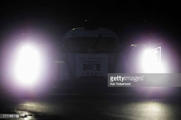 The Audi Sport etron quattro of Lucas Di Grassi Marc Gene and Oliver Jarvis drives during the Le Mans 24 Hour race at the Circuit de la Sarthe on...